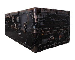 Used Antique Steamer Trunk - This antique black steamer trunk has character that can't be replicated. The trunk opens upright to reveal three drawer compartments on the right and one open hanging clothes section to the left. Sliding support rods on the left side hold hangers. Please note, the leather handle is torn, and the middle latch is missing in the front. There is also an unattached hinge in the left rear. No key, or hangers included.