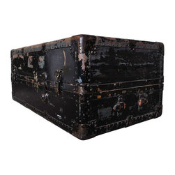 Pre-owned Antique Steamer Trunk - This antique black steamer trunk has character that can't be replicated. The trunk opens upright to reveal three drawer compartments on the right and one open hanging clothes section to the left. Sliding support rods on the left side hold hangers. Please note, the leather handle is torn, and the middle latch is missing in the front. There is also an unattached hinge in the left rear. No key, or hangers included.
