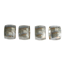 Used  Hammered Silver Toned Napkin Holders - Set of 4 - Shimmering silver without the sterling price tag. These hammered napkin rings are made of a metal with a silver tone finish. They are gently used in very good vintage condition. 4 in the set.