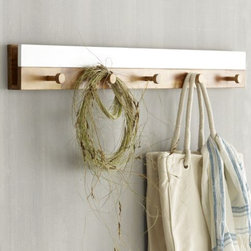 West Elm - Lacquer Coat Rack - I have always thought that your coat rack should be as stylish as your home and the jackets that get hung on it. West Elm delivers this wish with their beautiful 5-pegged coat rack.