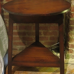 British Traditions - Small Round Table w 3 Legs & Shelf Below Top (Stone) - Finish: Stone. Each finish is hand painted and actual finish color may differ from those show for this product. Small round table. 3 Legs. Shelf below top. Minimal assembly required. 25 in. L x 25 in. W x 25 in. H (23 lbs.)The Baby Cricket Table is a smaller version of our popular Cricket Table. Perfect in pairs for bedside or end tables, or alone as an occasional table.