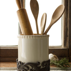 """GG Collection - Utensil Holder - GG CollectionUtensil HolderDetailsFrom the GG Collection. Crafted of ceramic and cast aluminum.6.25""""Dia. x 7""""T. Ceramic is dishwasher safe. Imported.Designer About GG Collection:GG Collection is the brainchild of two friends Dixie Harrigan and Leigh Anne Baysinger who wanted to make accessories for those who prefer classical decor to modern influences. Together they started a movement for the revival of the classic European style beginning with Tuscan-inspired canisters and spice jars then expanding to include dinnerware and other decor. Their creative combination of metal stoneware and mouth-blown glass achieves the relaxed European-country style they were striving to create."""