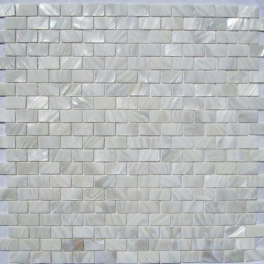 """White Mother of Pearl Minibrick 5/8"""" x 1"""" Tile - Mother of pearl tiles add new and unique elegance to your bathroom, backsplash, headboard, and more. Our Mother of Pearl tiles are handmade from genuine natural freshwater pearls. Although Mother of Pearl tiles are naturally thin, they are very strong and durable as well as easy to install in kitchens, bathrooms, and pools."""