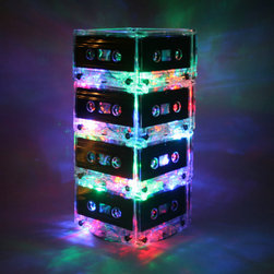 Unique Upcycled Mixtape Light by Break the Record - What an illuminating way to upcycle cassette tapes! They might be obsolete, but they're still a big part of music history. And now they're getting new life as a unique lamp.