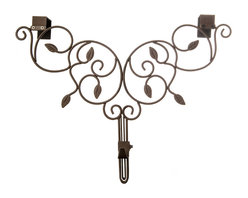 Village Lighting - Ivy Adjustable Wreath Hanger - Have a beautiful wreath and want to showcase it against your door? Why not add an elegant and festive wreath hanger. The unique double top hanging bracket design offers extra strength and a stunning unique design. The hanger is also adjustable to suit your door style: whether your door has a window or decorative molding on the front or just recessed decorative trim, the adjustable wreath hanger is the perfect solution. Each hanger is designed to hold your treasured wreath without causing damage to your door. The classic design is scrolled in sturdy, durable iron and will hold up for years to come. A perfect companion to the Garland Hanger!