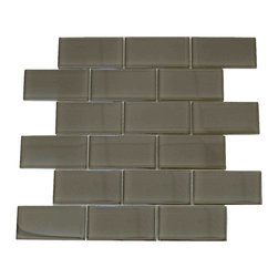 """Spa Glass - Light Brown 2X4 Subway Glass Tile, Light Brown, 2x4, Carton - CARTON of Light Brown 2X4 subway glass tile consisting of 20 square feet or sheets. This tile is manufactured in a thinner 1/8 inch thick format and is a high quality """"POOL RATED"""" glass subway tile that is perfect for a kitchen backsplash, bathroom tile, shower tile or pool tile. Because the tiles are thinner and come mesh mounted in a staggered interlocking brick pattern, installation is much easier and much less expensive. The thinner profile eliminates the need for tear outs or large demolitions. You can tile over existing materials and eliminate installation cost ( think DIY).These are a very high grade glass subway tile kilned at 800 Celsius for maximum durability and come with a baked polypropylene backing which reflects the color back thru a very clear glass.  The tiles come in a 12X12 inch sheet consisting of 18 tiles 2X4 inches in size.  They come in boxes of 20 square feet or 20 sheets. There is also a SAMPLE option so you can confirm the color is perfect for your space. The Price listed is for a single CARTON OF 20 SQUARE FEET."""