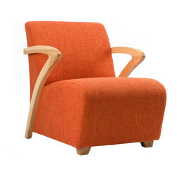 L Chair in Orange - Contrasting graceful swooping lines with sumptuous cushioning, the L chair is the perfect place to relax.