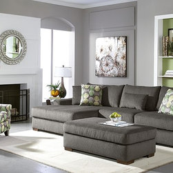 The Oasis Living Room Sofa Collection - Great Escape. Make your living room an escape to softness and style with our Oasis collection! Oversized for the ultimate in stretch-out relaxation, this group puts day-to-day comfort at the forefront, with its thick cushions, contoured arms and extra-soft chenille fabric. Its rich gray color lets you in on today's hottest neutral, so you can decorate the rest of your living room with abandon. Modern toss pillows show shades of gray, black, yellow and green with plenty of visual motion.