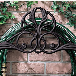 Ballard Designs - Genoa Hose Holder - Cast aluminum construction. Powder coated to resist rust. Scroll motif. Holds up to 100' feet of hose. This decorative Hose Holder keeps your hose near the spigot and easy to reach. Holds up to 100' of standard size garden hose. Crafted of cast aluminum with scroll decoration and powder coated to resist rust and weather. Made in the USA. Simple assembly.Hose Holder features:. .  . .
