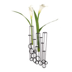 Hive - Crokkis Wall Vase - The Crokkis Wall Vase supports glass tubes that can be filled with water, dried plants or any other decorative material. The end user participates in the creative process by filling in this design. Available in Black. Available in four sizes. Small: 10.25 inch depth x 6.25 inch width x 21.625 inch height.  Medium: 21.625 inch depth x 6.125 inch width x 25.625 inch height. Right down: 8.125 inch depth x 4.375 inch width x 17.75 inch height. Right up: 9.625 inch depth x 4.375 inch width x 17.75 inch height.