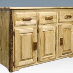 """Montana Woodworks - Glacier Country Sideboard - This quality sideboard is handcrafted from solid, American grown wood and designed to withstand decades of daily use. Truly an heirloom quality item. Use the sideboard in your kitchen or dining room to serve food or display your fine serving dishes. Finished in the """"Glacier Country"""" collection style for a truly unique, one-of-a-kind look reminiscent of the Grand Lodges of the Rockies, circa 1900. First we remove the outer bark while leaving the inner, cambium layer intact for texture and contrast. Then the finish is completed in an eight step, professional spraying process that applies stain and lacquer for a beautiful, long lasting finish. Three raised panel doors conceal a large storage area measuring approximately 50"""" W x 18"""" D x 20"""" H. The sturdy fixed wooden shelf in the storage area measures 50"""" W x 18"""" D x 3/4"""" thick and is centered in the storage area, allowing approximately 10"""" of space above and below the shelf. Each of the three drawers measure 11"""" W x 17"""" D x 5"""" H. Comes fully assembled. 20-year limited warranty included at no additional charge. Hand Crafted in Montana U.S.A.; Solid, U.S. grown wood; Unique, one-of-a-kind Glacier Country style.; Heirloom Quality; 20 Year Limited Warranty; Durable Build, Fit and Finish; Each Piece Signed By The Artisan Who Makes It; Solid Wood, Edge Glued Panels; Easy Glide Drawer Slides and Quality Hinges. Dimensions: 55""""W x 21""""D x 36""""H"""