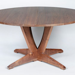 Custom Tables | Split-Pedestal Extension Table - This stunning walnut table can be extended with up to three leaves. Closed, it has a round top and a unique solid base. When extended, it comfortably sits 8 people. The pedestal splits to accommodate and support the additional size. (Shown closed here)