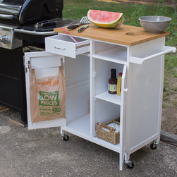 None - Nordic Furniture Butcher Block Rolling Kitchen and BBQ Workstation - Use the workstation as a chopping station,complete with refuse portal that allows unwanted pieces to fall into a garbage bowl.