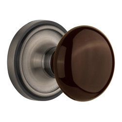 Nostalgic - Nostalgic Passage-Classic Rose-Brown Porcelain Knob-Antique Pewter (NW-710441) - The simple elegance of the Classic Rosette in antique pewter offers beauty and durability that will compliment a variety of architectural styles. Adding our rich, Brown Porcelain knob only serves to compliment the warm, earthen hues in your home. All Nostalgic Warehouse knobs are mounted on a solid (not plated) forged brass base for durability and beauty.