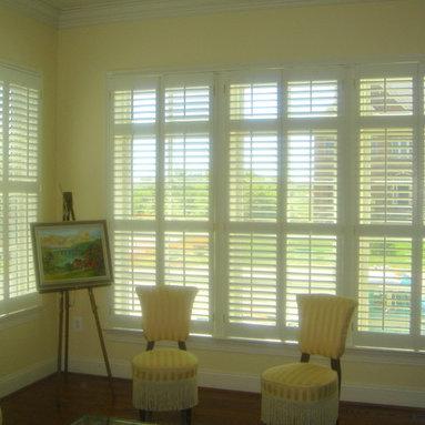 Shutters - Plantation shutters on a window.  Two divider rails on the triple window.