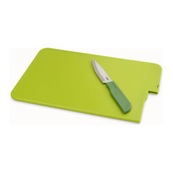 """Joseph Joseph - Slice and Store, Green - The Slice & Store is a unique compact chopping board with an integrated knife, making it convenient for performing most food preparation tasks. The blade is made from high quality Japanese stainless steel and stores away safely after use. This handy set is also perfect for picnics and camping. Dishwasher safe. By Joseph Joseph. Grey. Overall Slice & Store measures 12.6 x 8.66 x 0.3"""""""