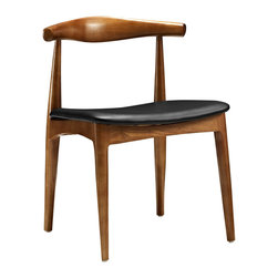 Tracy Dining Side Chair - The Tracy Dining Side Chair features a mid-century slightly curved back made of wood and a foam padded seat upholstered in black leatherette.