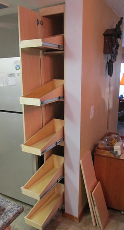 Pull Out Shelves for a Narrow Pantry - Create an organized pantry with custom pull out shelves from ShelfGenie of Portland, designed to fit your existing space.  Increase your ability to see and reach stored in your pantry, ultimately saving you time and money.  Sloped shelves keep tall items securely in place.
