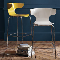 Wrap Bar + Counter Stool | West Elm - Stools that gives their occupants a big hug. Comfortably wide, the bent-wood design is a mod, streamlined spin on a classic wingback silhouette.