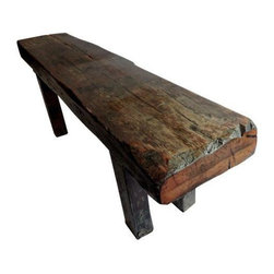 Pre-owned Rustic Bench made of Ship's Timbers - If this rustic bench could talk, it would tell tales from the sea. It was fashioned from the timbers of a whaling ship, taken from a Depression Era gathering spot in Massachusetts. It has the most amazing patina and rustic feeling with its own special history.     The legs have been recently reinforced, so the piece is very sturdy and heavy. It's in excellent vintage condition.