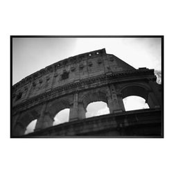 """Michal Venera Framed Print, Coliseum I, No Mat, 28 x 42"""", Black - On first glance, these iconic images of Rome are striking for their lush sepia tones, rich detail and intriguing camera angles. A closer look reveals the beauty of patterns, whether it is hundreds of stones that make up an old street, arches in the coliseum or the remaining three columns of a ruin. All exude a sense of order and timelessness amid the ever-changing landscape of city and country. 13"""" wide x 11"""" high 20"""" wide x 16"""" high 42"""" wide x 28"""" high Alder wood frame. Black or white painted finish; or espresso stained finish. Beveled white mat is archival quality and acid-free. Available with or without a mat.{{link path='shop/accessories-decor/pb-artist-gallery/artist-gallery-michal-venera/'}}Get to know Michal Venera.{{/link}}"""