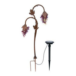 "Trendscape - Outdoor Lighting. Twin Head Grape Lighting Bronze Solar LED Path Light - Shop for Lighting & Fans at The Home Depot. Solar powered ""Vintage look"" grapes with real art glass flowers which are hand crafted and light up with elegance at night. Position in your garden to add charm and lighting effects. Beautiful by day and night twin head version."