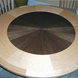 Custom Furniture - The center of the table is walnut, the perimeter is tiger maple.  Our customer wanted to incorporate other furniture pieces in their kitchen/family room.