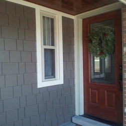 Gray HardieShingle Siding - James Hardie Fiber Cement Shingles - Gray Shingle Siding by James Hardie in Fiber Cement material with wood grain texture. Installed Opal Enterprises, Inc in Downers Grove, Illinois.