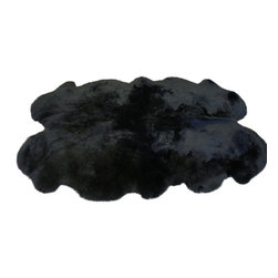 Bowron USA - Authentic Sheepskin Rug, Quarto, Black - Bowron Sheepskins have been hand crafted with pride by G. L. Bowron & Co. Ltd. New Zealand since 1879 when two brothers, George and William Bowron, master tanners of Yorkshire, England, set sail for Christchurch in the new colony of New Zealand. They were to embark on a new life and carve out their personal dream of developing and opening up a tannery bearing their own name. At the time, the population of Christchurch was a modest 29,000 but already the surrounding province of Canterbury was considered to be the leading agriculture centre of New Zealand, renowned for the quality of its sheep flocks. As the small tannery flourished in Christchurch, a family tradition of excellence in lambskin and sheepskin tanning and manufacturing began.