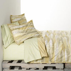 Landscape Full-Queen Duvet Cover - New horizons in tone and texture for the contemporary bed. Flowing landscapes with organic texturing are printed in a rich palette of golds and browns, beiges and greys to resemble an elaborate patchwork quilt. Duvet cover with stabilizing duvet ties reverses to solid sandy brown. Duvet inserts also available.