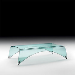 Genio Bent Glass Coffee Table - Coffee Table by Massimo Iosa Ghini. This Modern Contemporary Glass Coffee Table is structured with a single piece of 10 or 12 mm-thick tempered glass curved at 2 sides to form its body and legs. Genio provides a flat top surface and enough room underneath for displaying magazines or books or other accessories. With lots of curves combined with oval shaped aluminum floor tips. Genio coffee table will stand out in any contemporary space. Accentuate your living room or office reception area with this unique furniture piece.