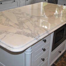 Contemporary Kitchen Countertops by Ogle, luxury kitchens, Bathrooms & Stonework