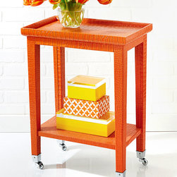 Orange Cote d'Azure Phone Table - A vivid, vibrant alternative to a traditional bar cart, the Orange Cote d'Azure Phone Table glides on nickel-plated wheels to bring its high-sided top tray and convenient undershelf to the spaces where you need an extra surface.  The structure is entirely covered in faux crocodile leather dyed a zesty, saturated orange, unifying the structure of tapered legs and bordered top.