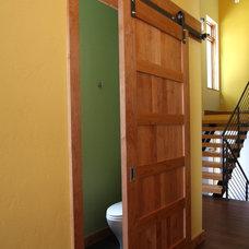 Modern Powder Room by Pinnacle Mountain Homes