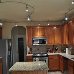 Residential LED Lighting - Kitchen & Gallery April2013 - LED flexible track lighting kit customized for residential kitchen. Complete systems start at $435.95, with 15-20% discounts and free shipping offers occurring regularly.
