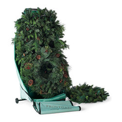 """Frontgate - Rolling Wreath and Garland Caddy - Easily fits four or more 9-foot garlands and two wreaths (up to 32"""" dia.). Sturdy steel frame and wheels. Garlands and wreathes are protected, but not crushed. Durable 600-denier polyester protects your valuable investment.. Plastic-lined bottom panel protects while you store. Store treasured holiday greenery with our Wreath and Garland Caddy. This holder protects the shape of your decor during storage and easily fits four or more 9-foot garlands and a pair of 32"""" wreaths. A whole front door decor set is kept secure and ready for you to install the following holiday!  .  .  .  .  . Large side pockets fit wreath or garland hangers and other decor . See how our storage bags outperform all the rest ."""