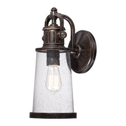 Quoizel - Quoizel SDN8407IB Steadman Outdoor Wall Lantern - This fixture gives the exterior of your home both beauty and an industrial sense of design.  It features a vintage bulb for a historic look and is enhanced by the clear seedy glass.  The Imperial Bronze finish completes the look.