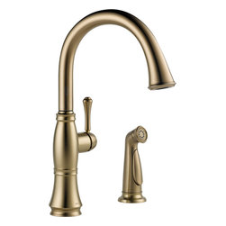 """Delta - Delta 4297-CZ-DST Cassidy Single Handle Kitchen Faucet with Spray - Delta 4297-CZ-DST Cassidy Single Handle Kitchen Faucet with Spray. Delta Classical design combines with modern technology in the Cassidy Kitchen Collection. The Cassidy Collection is a great choice for a timeless, or traditional kitchen. Subtle and elegant curves add to the simplicity of the faucet. Features Euro-Motion handle that only rotates forward to eliminate backsplash interference. A 10-1/8"""" spout that rotates 360 degrees, and matching side spray for cleaning pots and pans, or even veggies. Faucet comes in a Champagne Bronze Finish for added beauty."""