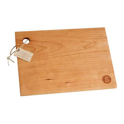 Monogram Cutting Board (large, cherry)  - X - Worried about cutting on something so beautiful? Don't be - that's what the back is for! In this way, our cutting boards serve as both a charming addition to your home decor as well as a functional piece in the kitchen. Maintain the quality of your cutting board with occasional applications of mineral oil. Simple monogram stamp design on one side, Solid cherry or hard maple wood, Handmade from start to finish