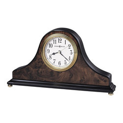 Howard Miller - Howard Miller Baxter Table Top Clock - Howard Miller - Mantel / Table Clocks - 645578 - This traditional table clock has a definitive Old English charm to it and is just as well-suited to any mantel as it is to a table top. Distinguished by its wood burl detailing polished brass waterfall bezel and classic white dial the Baxter glows with a particular charm. Quartz movement and a high-gloss walnut piano finish round out the appeal of the Baxter Table Top Clock.