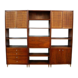 """Used Mid-Century Modern 3-Piece Modular Cabinet - A Mid-Century Modern modular wall unit cabinet with Danish style tapered legs, cane cabinet doors, pull down desk, adjustable shelving, a storage cabinet and drawers below. It is in good vintage condition with some wear and scratches on the wood, additional pictures are available upon request. Use the units separately or together. This cabinet would be a great addition to any Mid-Century, eclectic, or Danish Modern décor.    Each section measures 30.5"""""""