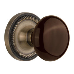 Nostalgic - Nostalgic Privacy-Rope Rose-Brown Porcelain Knob-Antique Brass (NW-710756) - Blending rich detail and subdued refinement, the Rope Rosette in antique brass captures a style that has been a favorite for centuries. Adding our rich, Brown Porcelain knob only serves to compliment the warm, earthen hues in your home. All Nostalgic Warehouse knobs are mounted on a solid (not plated) forged brass base for durability and beauty.