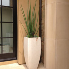 Traditional Outdoor Planters by Pacific Stone Design Inc