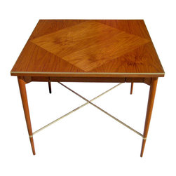 """Tables & Case Pieces - This dining or game table features a gorgeous inlaid wood surface which is supported by four tapered wooden legs. The legs are connected by a brass """"X,"""" which supports the piece and highlights the brass piping around the edge of the surface. The table skirt hides a single pull out drawer. - See more at: http://www.galeriesommerlath.com/inventory/walnut-game-table-paul-mccobb/#sthash.RL0lMvnd.dpuf"""
