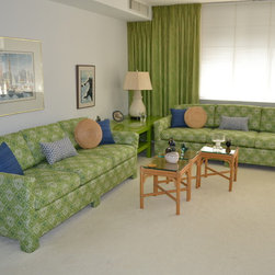 Furniture Reupholstery - This pair of sofas for a vacation condo on the Atlantic City boardwalk was reupholstered in Sunbrella fabric by Robert Allen. The blue pillows are a Scalamandre fabric and the lumbar pillows are a fabric by Kravet.
