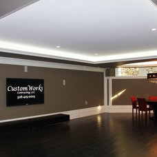 Contemporary Basement by CustomWorks Contracting, LLC