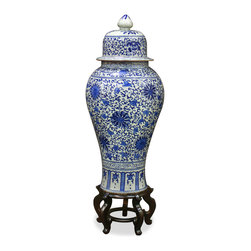 China Furniture and Arts - Blue & White Porcelain Ginger Jar - With symmetric proportions and a sleek silhouette, this tall vase makes a great accent piece for any contemporary setting. It is hand-crafted of porcelain with a delicately hand-painted floral pattern in traditional blue and white motif. Practical as a decorative accent or as a centerpiece, it is sure to be admired for its beauty. Imported. Matching wooden stand sold separately.