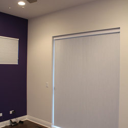 Hunter Douglas Duette Vertiglide Shades by Skyline WC - Chicago - Light control was a major concern for the customer.  Honeycomb shades with blackout are an excellent choice with those concerns in mind.