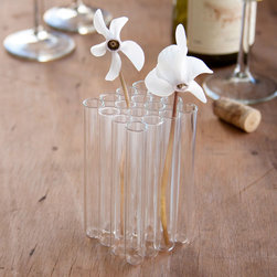 Glass Bud Vases - 16 delicate glass tubes come together to form a beautiful, unique centerpiece. They're packed tightly together, ready to showcase a beautiful bunch of flowers on your desk at work.