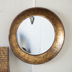 Gold Cup Mirror - This mirror lights up the room with its gleaming, antiqued gold frame. The textural patina is the perfect complement to the smooth, silvery mirror face.